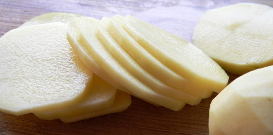 Grate 2 chilled potatoes to make its juice.  Use cotton and soak it in potato juice to apply it over closed eyes. Let it settle for 10-15 minutes. Rinse off with cool water. Potatoes act as a bleaching agent to lighten the skin. Potatoes can be an effective way for some people to get ridof dark area