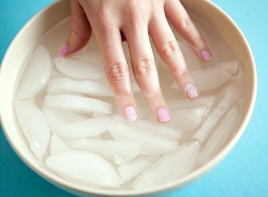 Take a bowl and pour ice cold water in it. Pop in some ice cubes and dip your fingers in for at least 2 minutes or however long you would like.