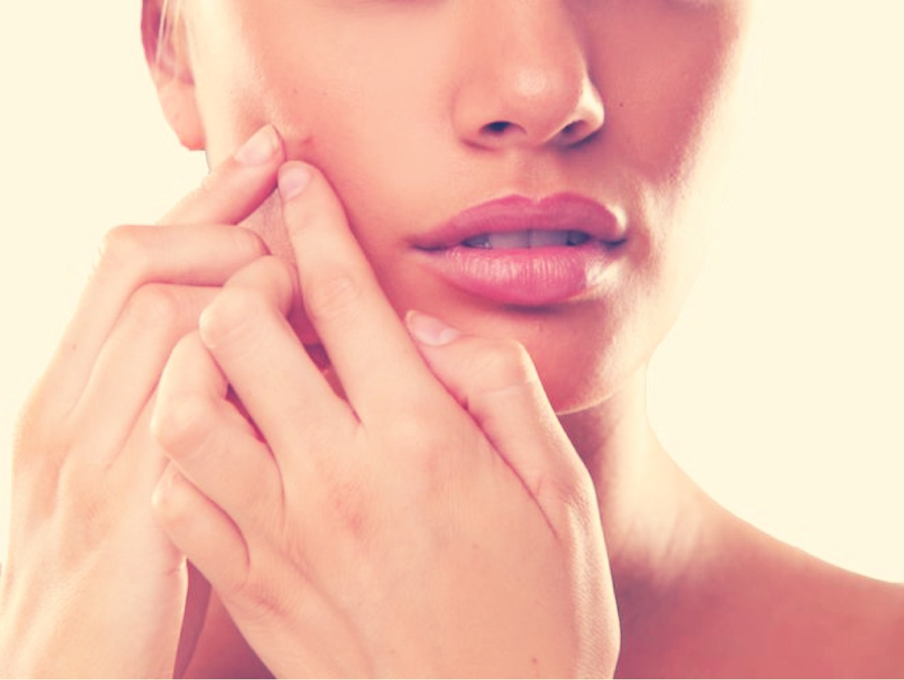 Don't pick!!! I know it's tough, but picking will only make the pimple take longer to heal & therefore longer to go away!