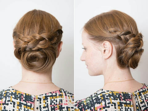 To achieve this look, Dutch braid the top half of your hair from your temples to the back of your head and secure each braid. Then, crisscross them at the back of the hair, and clip them up.