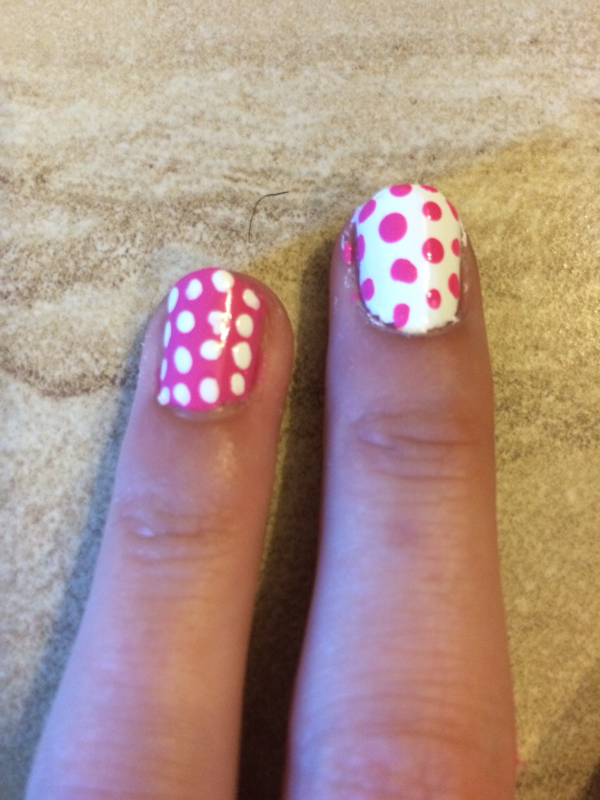 Paint each nail the opposite color with polkadots. You can open up a bobby pin, dip it in the nail polish, and dot it on your nails.
