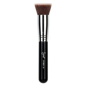 I dot the foundation all over my face with my fingers and then I take my foundation brush and blend it in evenly all over my face.