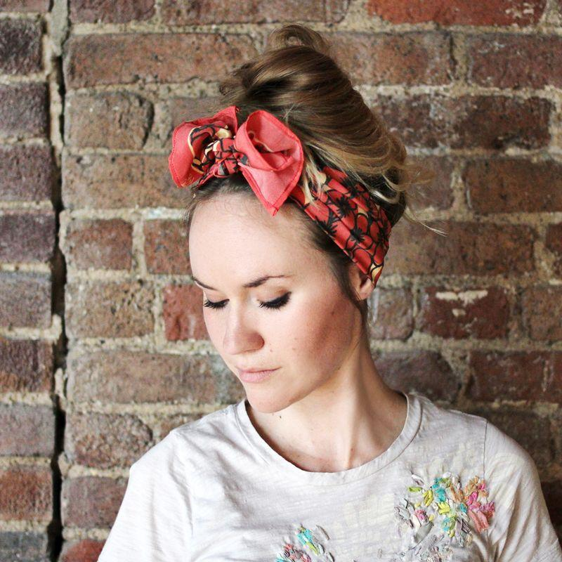 Style your hair into a messy bun or top knot. Fold your scarf into a long rectangle and tie around your head so the knots in the front. Style the knot by twisting or tucking parts of it in.