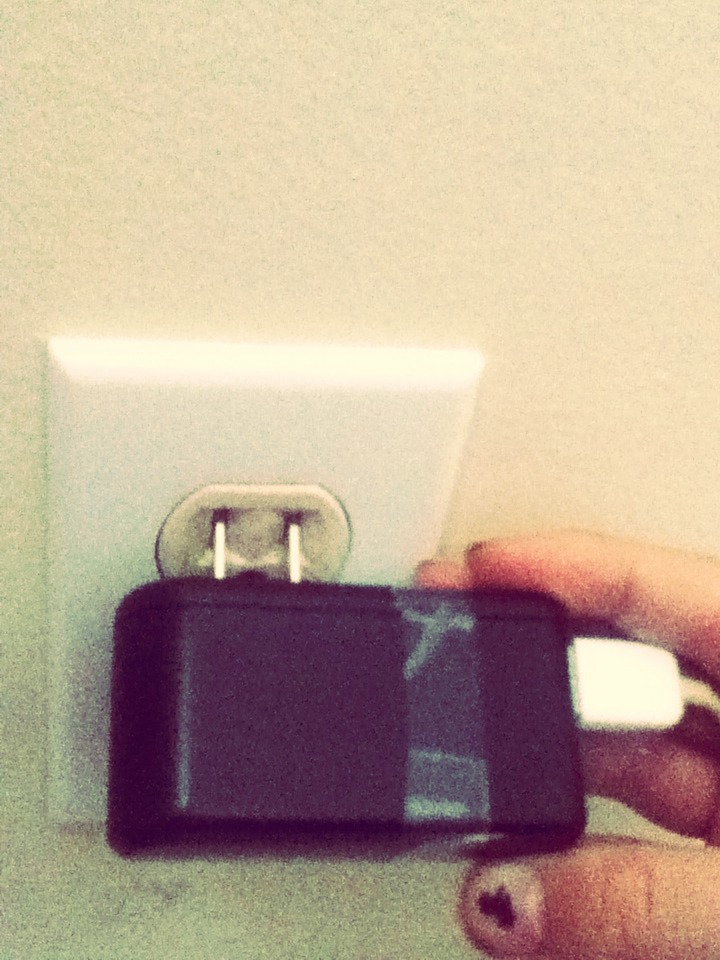 Take the two little metal pegs and carefully put them in the two slits on the outlet.