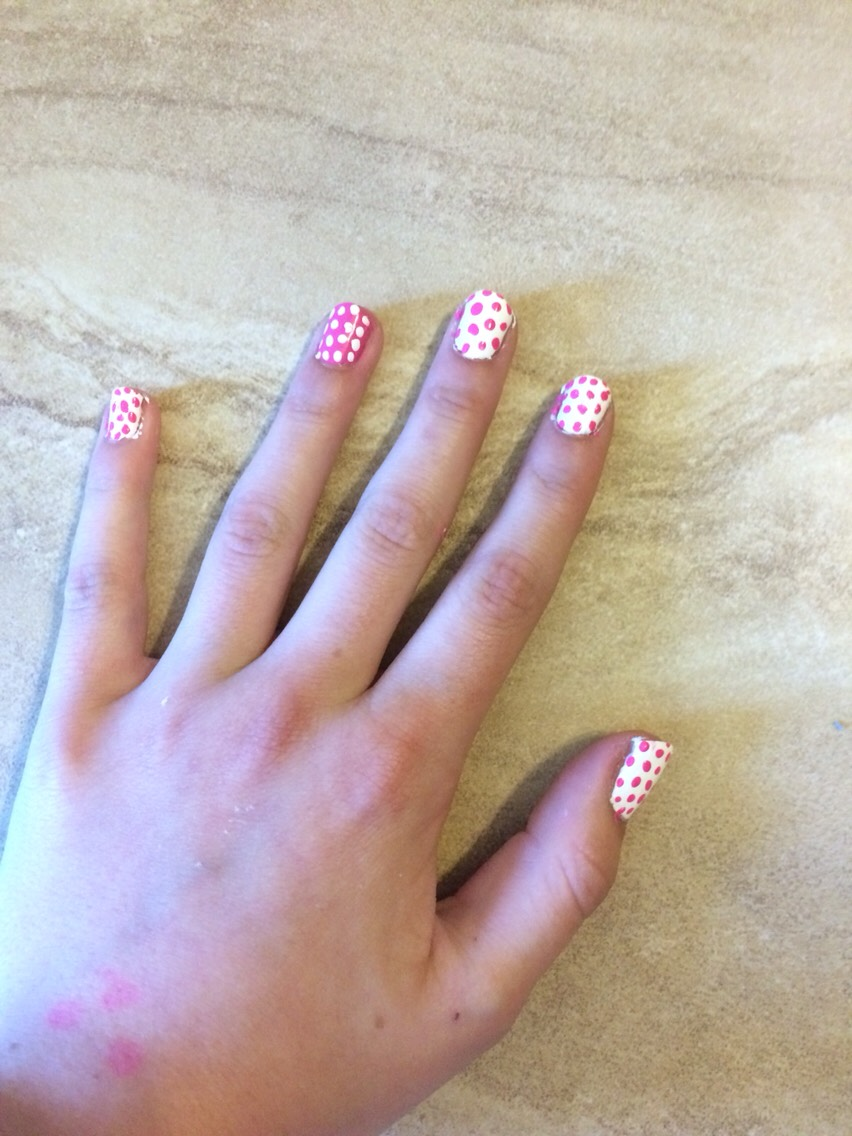 Paint all of your nails like that and voilà you have cute, polka dot nails!