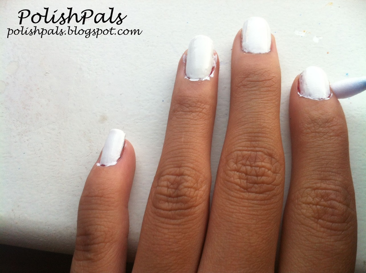 Dip and flat head brush and clean around the nails! This will make it easier to manoeuvre around the nails! If you don't have a brush, use a que tip!