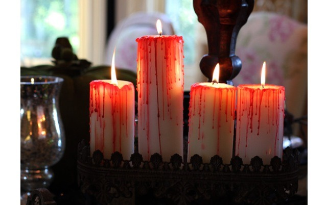 Bloody candles use red candle wax to do this.