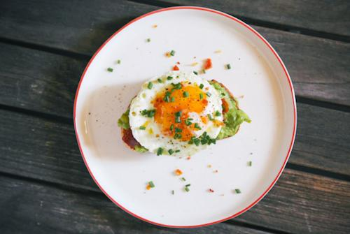 The Breakfast Classic  After spreading some mashed avocado on your favorite toast, fry up some bacon and make an egg sunny-side up. Top it off with some salt and pepper and you have yourself a delicious on-the-go breakfast. (Add some red pepper flakes if you want some spice!)