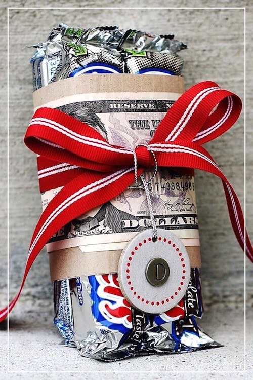 25. Creative Gift Wrap Sometimes it's all about the packaging! This is such a great idea for someone who is hard to shop for, like teenage boys. You just can't go wrong with money and candy. And, it doesn't get much easier than this.