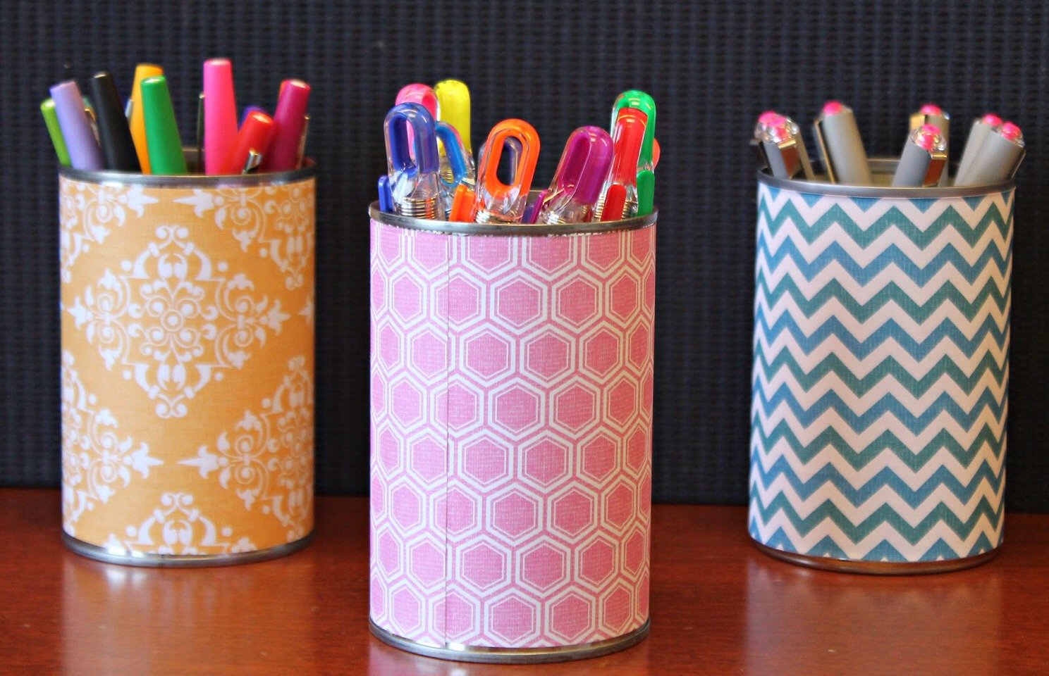 Super cute pencil cup!  Supplies needed: old can, wallpaper, hot  glue gun!