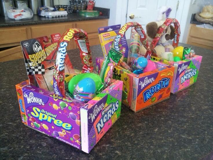 Glue four boxes of candy together, use a piece of cardboard for the bottom of the basket. (I used hot glue)