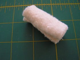 3. Fold the batting few times to make it look like the one in the picture and sew the end.