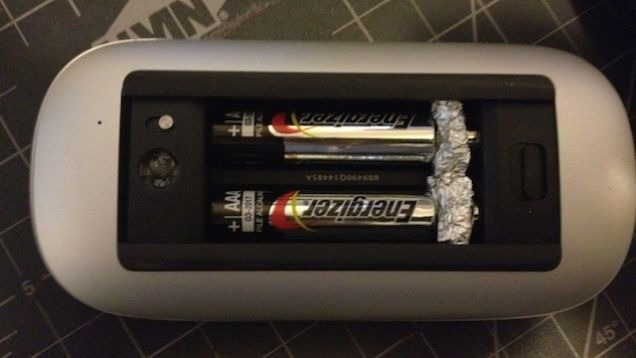 Use smaller batteries and fill in the gap with tinfoil. The tinfoil acts as a conductor between the gap.