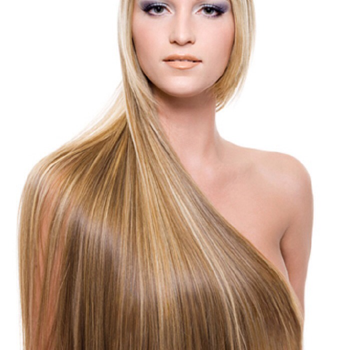 Use shampoos which have no sulphates in. Sulphates strip hair of moisture creating dryness and damage. This in turn creates split ends.  Loreal do excellent sulphate free shampoo. There are also better sulphate frees online, however they are more expensive.