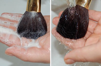 Keep scrubbing your brush on your hand until you see no more makeup coming off .( you can put on more olive oil and dish soap if it wasn't enough the first time . Then rinse.