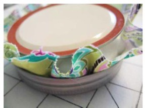 5. Check to see if you need to move the fabric to avoid creases. Make any necessary adjustments and then fold in the fabric and hot glue it to the underside of the lid.