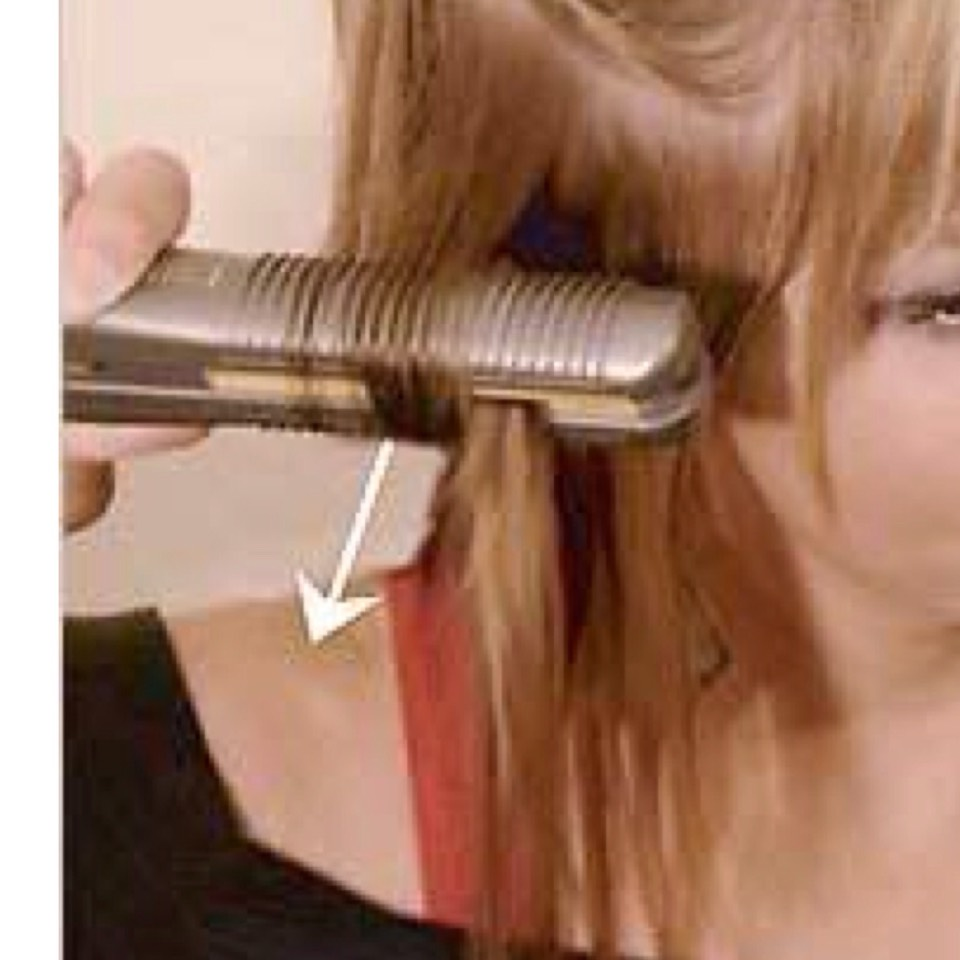Demonstrating how to curl..  Section hair Get some hair  Put between the ceramic plates Twist upwards and pull down