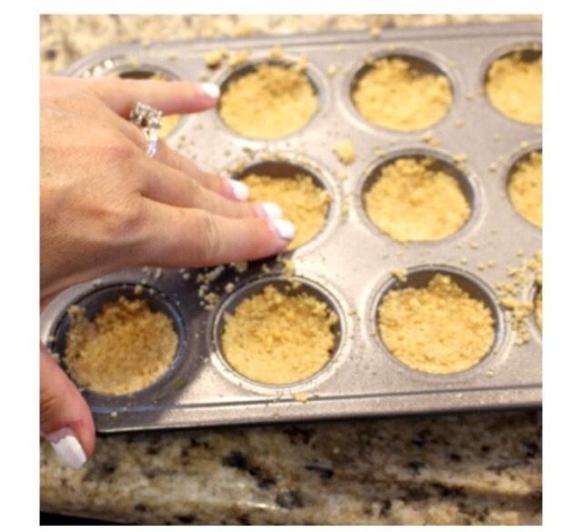 You're going to need a cupcake pan. You make the crust for the s'more bits with crumbled graham crackers and some melted butter to keep the crust from crumbling