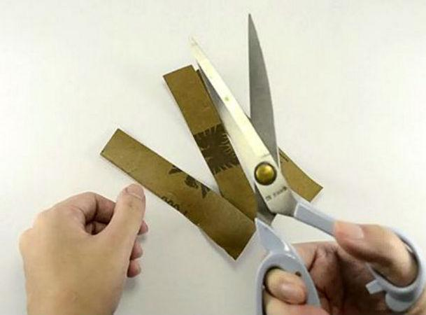 Cut sandpaper with scissors to sharpen them.