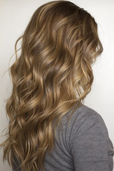 Subtle highlights and lowlights interspersed throughout golden brown hair have a gorgeous natural effect that can even make hair appear fuller overall.