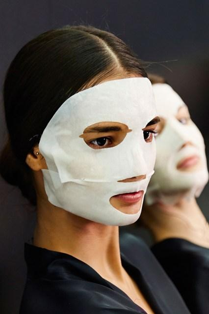 Many a non-believer of Korean skincare routines has been drawn in by sheet masks. Noncommittal, and creepy enough to scare your friends/bf.  Image: Vogue