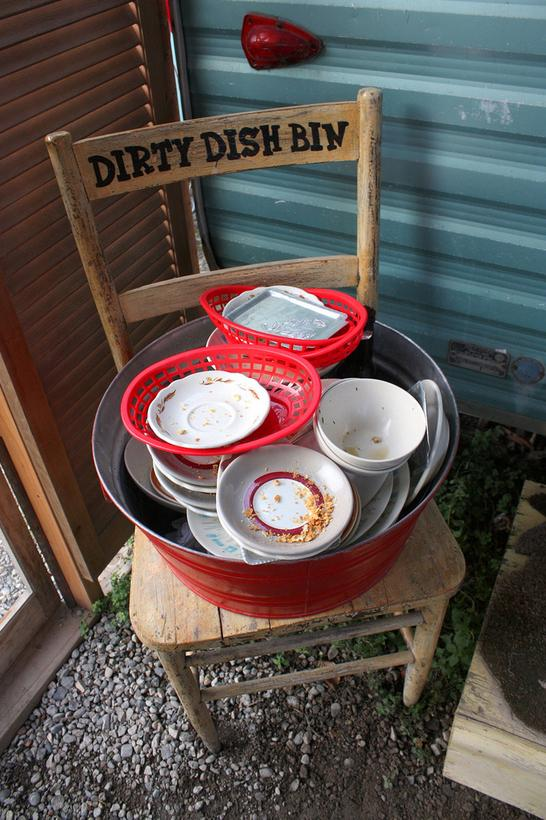 Set out a cute and clearly marked dirty dish bin for guests.