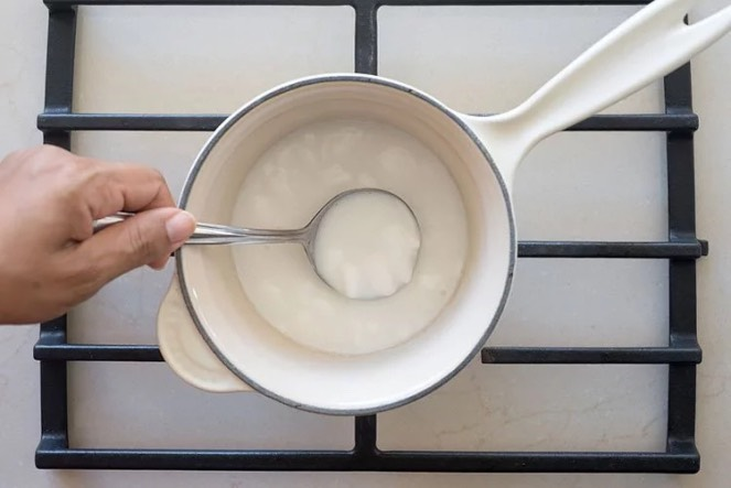"""4. Heat the coconut """"butter"""" at the lowest possibleheat setting. The idea is to heat it just enough for the water to evaporate. Virgin coconut oil is extracted at very low temperatures; high temperatures change its composition and properties."""