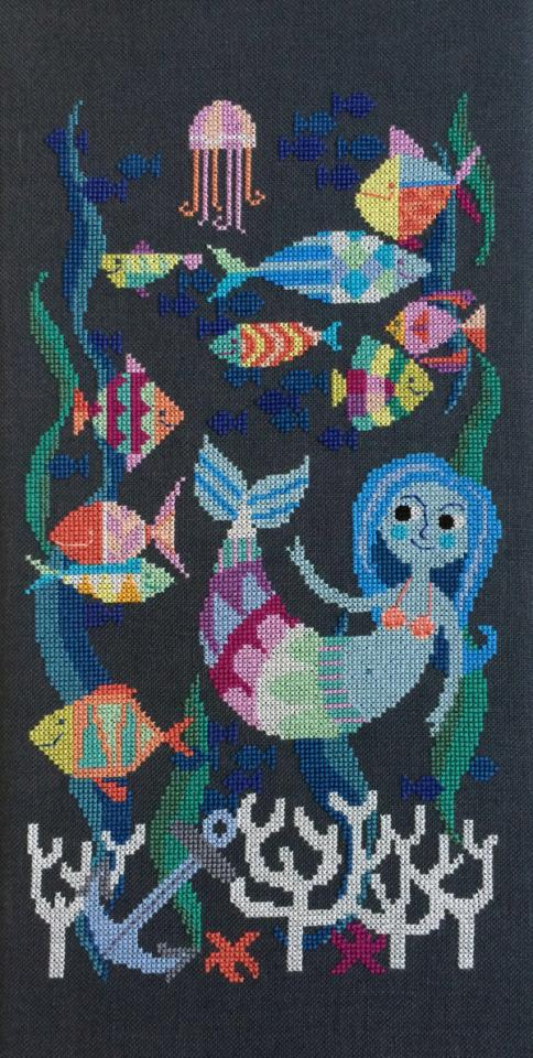 A cross-stitch pattern for mermaids with crafting skills.