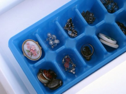 In Ice Cube Trays  This is an easy storage option that you probably already have at home.  Check it out at Apartment Therapy.  http://www.apartmenttherapy.com/organizing-with-ice-cube-trays-51712