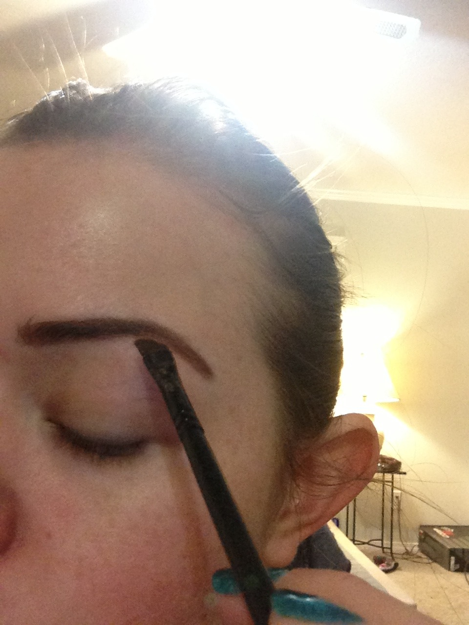Using the eye liner and brush make lines perfect