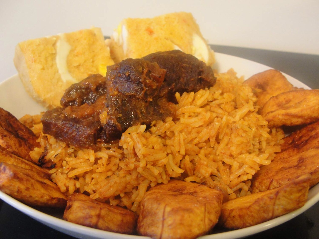 Jollof rice with plantain and stewed beef
