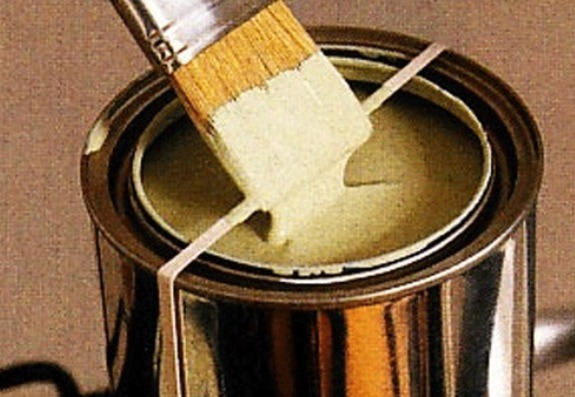 Use a rubber band to wipe excess paint off of your paint brush!