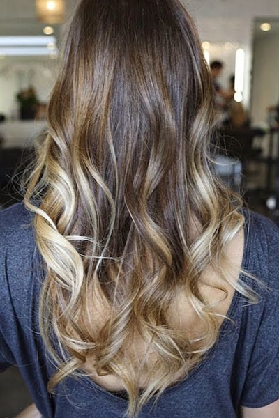 One way to try out blonde without going all the way is to work much lighter sections into the lower half of hair. You'll get a brightening effect without the frequent coloring commitment.