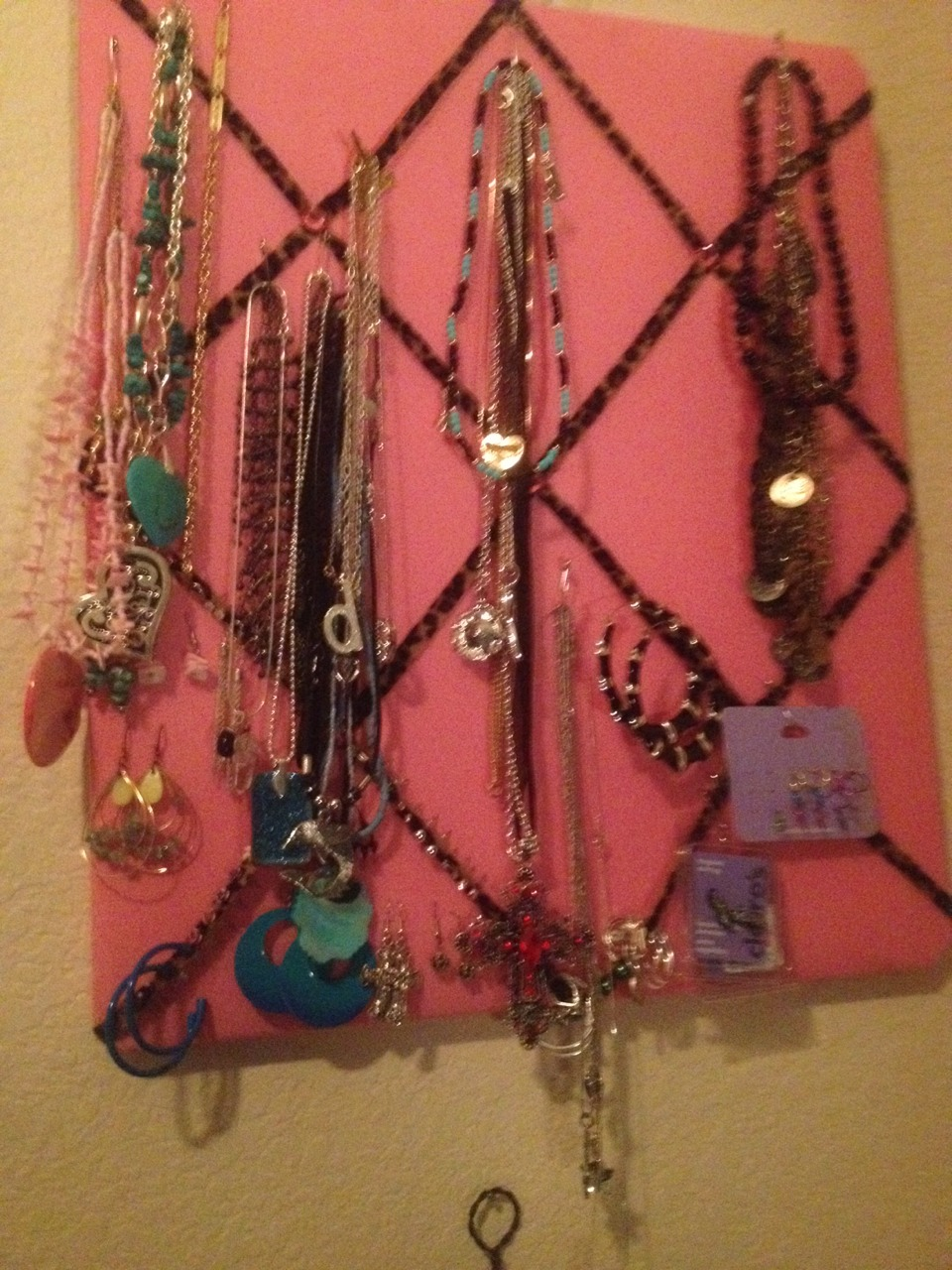 For my earrings I just stuck the studs and hoops through the ribbons and the other earrings went into the board itself. Then I just used safety pins to hand my necklaces . You can gets these kind of boards at places like Ross, Target or places like that. You could always use a cork board as well