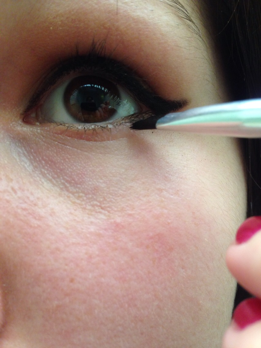 Now take the remaining liner on your brush and trace your lower lash line.