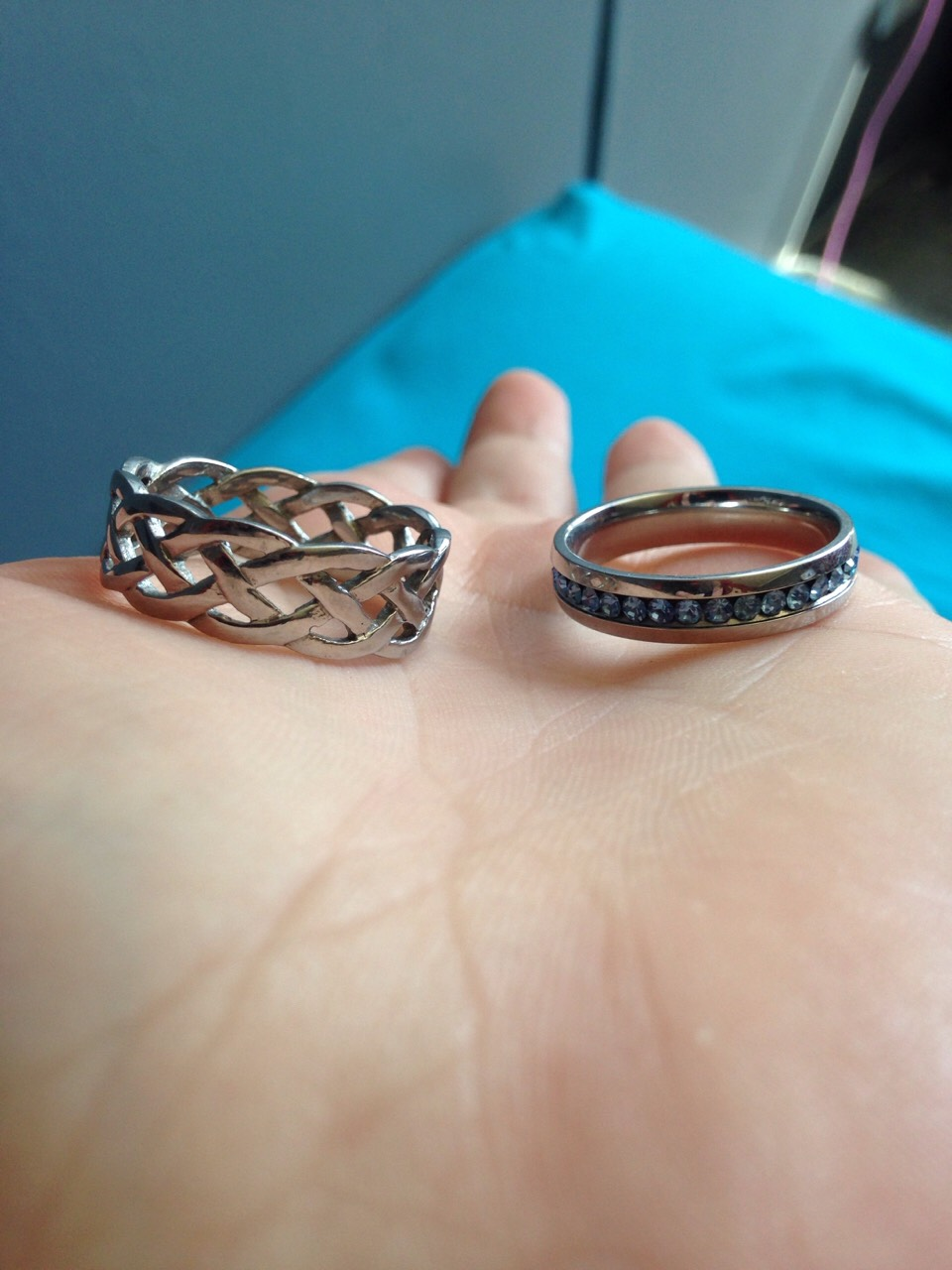 These are my rings. The braided one is 2 sizes to big and the regular jewel one is the correct size. I'm in love with the braided ring so I was set to keep it and wear it. This is how I did it.