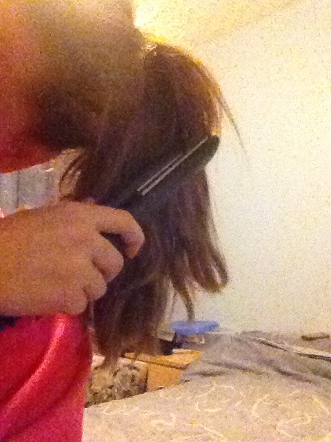 Straighten out the pony tail so you finish with a flat, straight pony