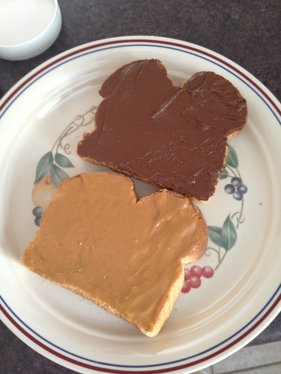 1) Toast your bread 2) Spread peanut butter on 1 toast 3) Spread Nutella on the other toast